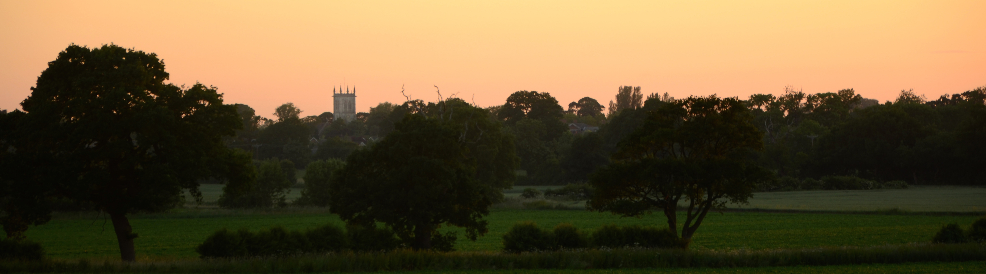 Photograph of Escrick at dusk showing St Helen's church